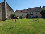 Large secure garden, with Children's Playarea, with playhouse, swings, slide and lots more toys.