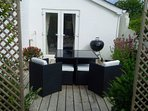 Lovely decking area with table and chairs for al fresco dining