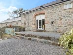 THE GRANARY, pet friendly, country holiday cottage,with a garden in Newborough,