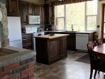 Fully Equipped kitchen with view of mountain.