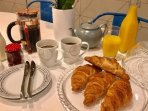 Breakfast provided for your first morning, croissants, butter, milk, fresh juice, jam, tea + coffee
