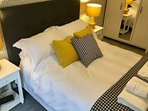 Bedroom 2 with wardrobe, hairdryer, television and chest of drawers. All linen and towels provided