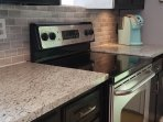 Electric range and oven and Keurig coffee maker,coffee and cream provided for our guests