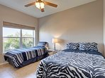 The 3rd of 3 bedrooms has two twin beds and a view to the north.