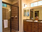 Adjoining master bathroom with standing shower