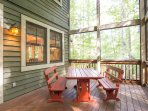 Enjoy a meal on the screened in back porch