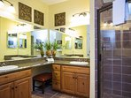 Adjoining master bathroom featuring two sinks