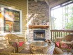 Enjoy relaxing by the outdoor fire place on the screened in back porch