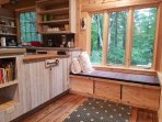 Entry seating or day bed with under bench storage.  Overlooking trails.