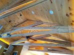 Gracious vaulted ceiling with in beam accent lighting.