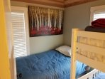 Third bedroom on street side of house. Bunk beds plus single bed.