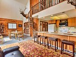 The interior features mountain-themed decor and a spacious open layout.