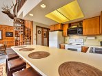 This fully equipped kitchen boasts ample counter space, updated appliances and natural wood elements.