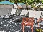 Bask in the sunshine from the condo's private beachside patio and barbecue area.