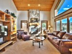 Step inside and unwind in the entrance living room with leather furnishings and a flat-screen TV.