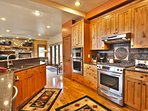 The fully equipped kitchen includes modern chef's-quality appliances, including a double-oven, which make home-cooked...