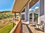 An expansive wraparound porch is perfect for taking in the views while sipping a favorite beverage.