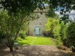 WEST WING COTTAGE, stone-built wing, woodburning stove, pet-friendly, romantic