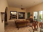 OUR NEWLY REMODELED FAMILY ROOM WITH 63' FLATSCREEN & SURROUND SOUND - ROARING FIRING PLACE...