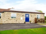 SOUTH BYRE, family friendly, country holiday cottage, with a garden in