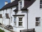 HUNISH Cottage is the largest of the coastguard row and has 4 generous bedrooms and living rooms.