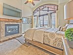 Upper Level Master Bedroom with a King Bed, Gas Fireplaces, 50' HD Smart TV, Full Private Bath, and Private Deck with...