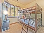 Upper Level Bedroom 2 with Full over Full Bunk Bed, Twin Trundle, 32' Smart TV and Shared Bath Access