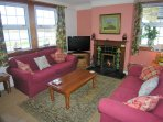 Relax! Cosy bright lounge with lovely views over Loch Cleat and open fire... coal & logs provided.