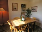 Bright dining room with seating for 8 and a handy serving hatch from the kitchen. Bon apetite!