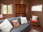 Casita dual comfy lounge chairs and ample windows for clear southwest daylight ambiance