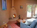Cozy wood burning Kiva fireplace in Casita Kachina studio