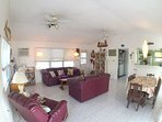 Spacious great room includes flat screen TV w/cable, DVD, CD/radio, local island artwork.