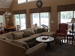 Great room- Kitchen, Dining, Living Area, walkout to screen porch overlooking lake.