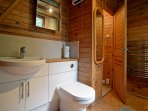The bathroom has a powerful electric shower and a generously sized bath.