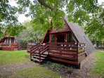 The cabin is one of twenty set within trees and landscaping on a private estate.