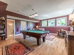 Games room with Pool table that converts to Ping Pong, Large Screen TV, Games Galore