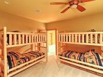 The Cub Cave boasts 3 sets of twin-on-twin bunk beds creating a cozy room to catch some Zs.