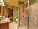 This sleek, full bathroom has everything you need to stay fresh on your getaway!
