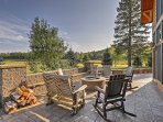 Sip on a glass of wine and relax by this fire pit with outdoor seating for 7 guests!