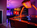 Air Hockey! Shuffleboard! Jukebox! Slot Machine! Popcorn! Hilltop Mansion has it all!