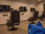 Go into battle together with 3 side-by-side Playstation 4s and gaming chairs!