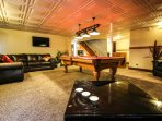 Billiard room with 50 inch TV, darts, poker table and laundry room