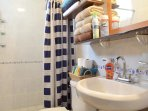 bathroom with quality towels, shampoo and body soaps for men and women