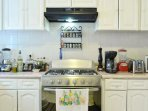 Kitchen with everything needed from pots to dinner ware