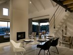 Willow Beach House - dining area with sea view at sunset