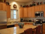 Island kitchen for efficiency and additional dining option