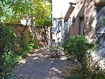 Delightful, beautifully landscaped adobe walled private enclosed patio