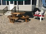 Picnic table with umbrella and gas grill on private beach