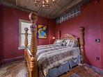 Comfortable queen-size, four-poster bed in private bedroom