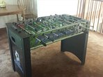 Fooseball table in loft.